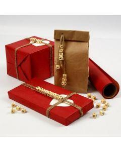 Presentinslagning med budskap av bokstavspärlor trädda på linsnören.