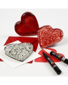 Transparent glashjärta med dekorerad baksida av kartong