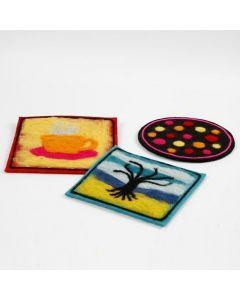 Bordsunderlägg av tjock filt med nålfiltad dekoration