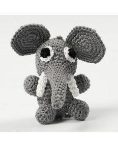 Virkad elefant som sitter