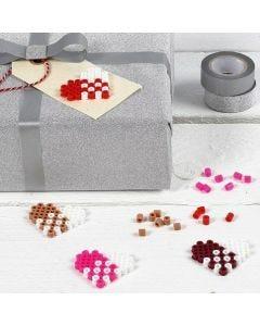 Manillamärke, dekorerad med hjärta av rörpärlor