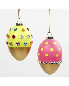 Målade ägg i olika färger och guld, dekorerad med rhinestones
