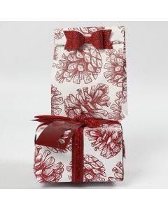 Presentinslagning med dekorationer och papper i design från Vivi Gade.