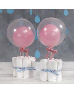 Bordsdekoration till babyshower av blöjor
