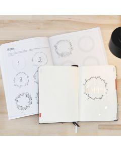 Bullet journal med hjälp av övningshäfte