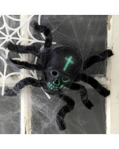 Spindel av kranium och piprensare som halloweenpynt
