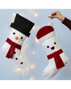Julstrumpa dekorerad som snögubbe och isbjörn.
