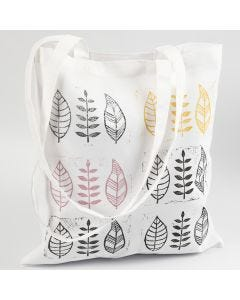 Egentillverkade stämpeltryck av blad på textil