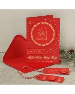 Ett julkort med en skäggig tomte