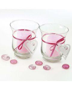 Ljusglas med bälte av hjärta i satinband.