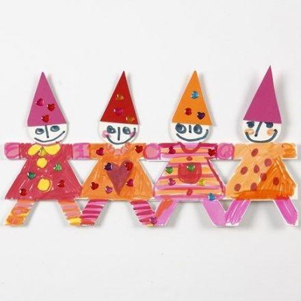 Julbård av dansande barn i utstansad papp