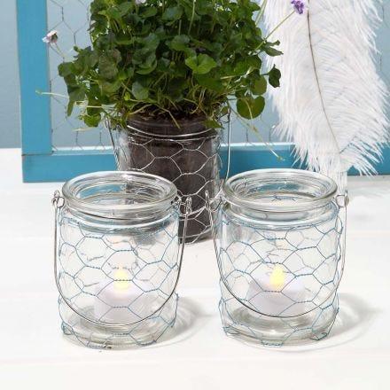 Ljusglas med ett bälte av färgad hönsnät