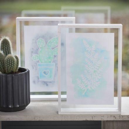 Tavlor med ritgummipenna och Aqua Paint i dubbelram