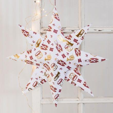 Stor julstjärna vikt av designpapper med nötknäpparen som motiv