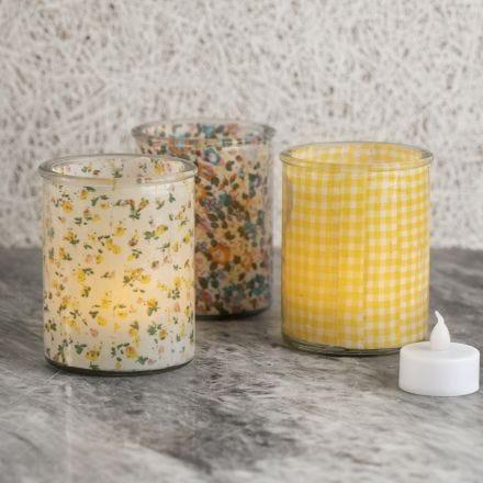 Ljusglas dekorerade invändigt med tyg