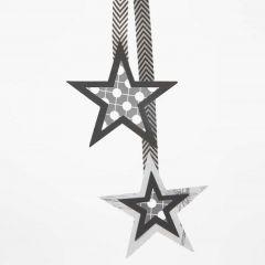 Pappersstjärnor i flera lager på band