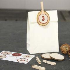 Dekorerade papperspåsar till kalendern