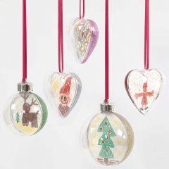Tvådelade dekorationer av klar plast, med teckning och glitter