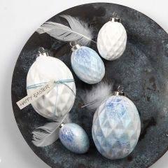 Spraymålade ägg av terakotta