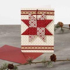 Julkort med flätad stjärna.