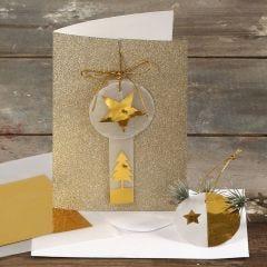 Kort med glitter, dekorerad med guld och vellumpapper.