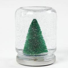 Snöglob av glasburk med dekorationer, vatten och glitter