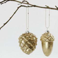 Glaskulor med guldglitter på insidan.