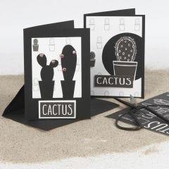 Dubbelkort dekorerade med utskärningar och designpapper