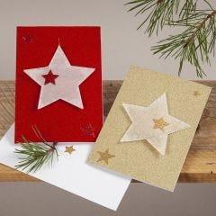 Julkort i glitter med stjärndekorationer av pergamentpapper