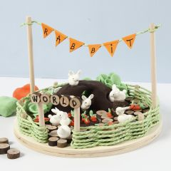 Miniatyr-värld med kaniner och morötter i Silk Clay