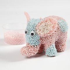 Elefant av papp klädd med Pearl Clay och rullögon