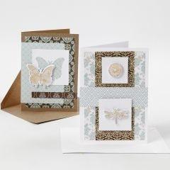 Kort dekorerade med designpapper och utstansade motiv med dekorationsfolie.