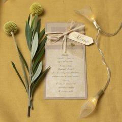 Menykort i kvistkartong med skelettblad som dekoration