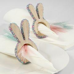 Servettringar till påsk av trä, dekorerade med miniglaskulor.