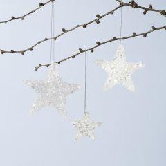 Glittriga stjärnor av Sticky Base och glitter.