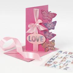 Kort dekorerat med fjärilar av diamond stickers