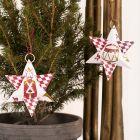 Julstjärna av designpapper med nötknäpparen som motiv