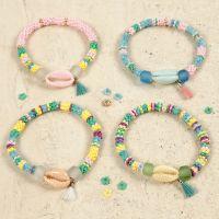 Armband med färgade snäckor och tofs