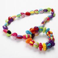 Armband och halsband med tvådelade pärlor