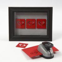 Hjärtan av kartong i 3D-ram med glas