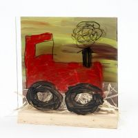 Traktor i landskap på 3D-platta med glas