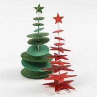 Julgran av utstansat dekorgummi på metallfot