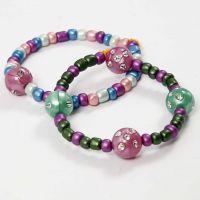 Armbånd af elastik med rocaiperler og perler med rhinsten