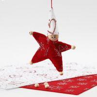 Stjärnformad tomtenisse av filt med glitter