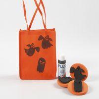 Orange påse till Halloween dekorerad med motiv