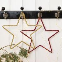 Virkad julstjärna på metallram