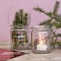 Lanternor av glas dekorerade med foliemotiv